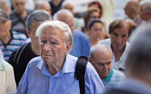 Pensioners waiting outside the main gate of the national bank of Greece to withdraw a maximum of 120 euros in Athens, on Thursday. Photo: AP