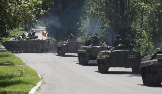 Members of the self-proclaimed Donetsk People's Republic forces ride on armoured personnel carriers (APC) near the urban settlement of Zaytsevo in Donetsk region, Ukraine, July 20, 2015. REUTERS/Alexander Ermochenko