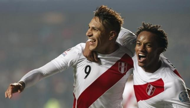 Peru's Paolo Guerrero (L) celebrates his goal against Paraguay with teammate Andre Carrillo during their Copa America 2015 third-place soccer match at Estadio Municipal Alcaldesa Ester Roa Rebolledo in Concepcion, Chile, July 3, 2015.  REUTERS/Andres Stapff