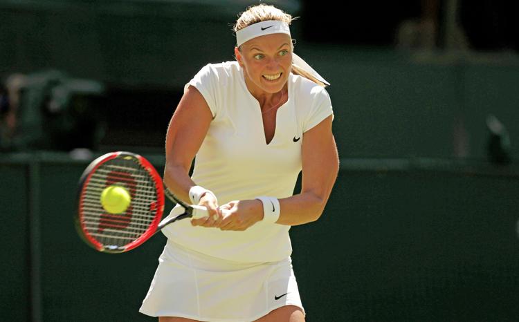 Czech Petra Kvitova returns to Netherlands' Kiki Bertens during their Wimbledon match in London on Tuesday. Photo: Reuters