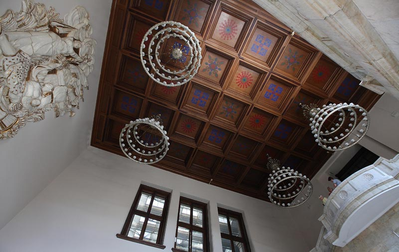 In this photo taken Monday, July 20, 2015, decorative box ceiling and chandeliers above a white marble staircase in the Palace of Culture and Science in Warsaw Poland, which was a gift from Soviet leader Josef Stalin and is celebrating its 60th birthday on Wednesday. Photo: AP