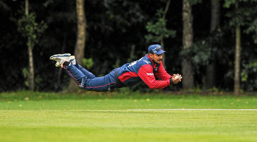 Pradeep Airee dives for a catch during the ICC World Twenty20 Qualifiers match against Hong Kong, in Belfast, on Wednesday. Photo: THT