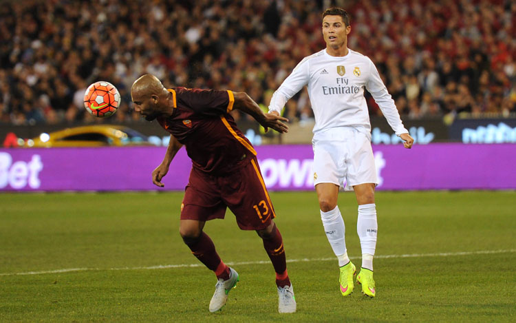 AS Roma's Maicon defends the ball as Real Madrid's Cristiano Ronaldo looks on during their nInternational Champions Cup match in Melbourne on Saturday. Roma won 7-6 on penalties. Photo: AFP