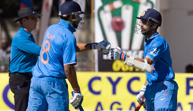India's Ajinkya Rahane (right) celebrates his half-century with teammate Murali Vijay during their second One Day International match against Zimbabwe in Harare on Sunday. Photo: AFP