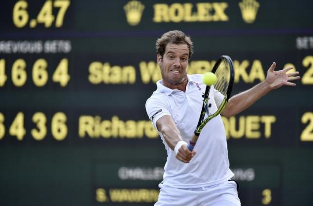 Richard Gasquet of France hits a shot during his match against Stan Wawrinka of Switzerland at the Wimbledon Tennis Championships in London, July 8, 2015.                            REUTERS/Toby Melville