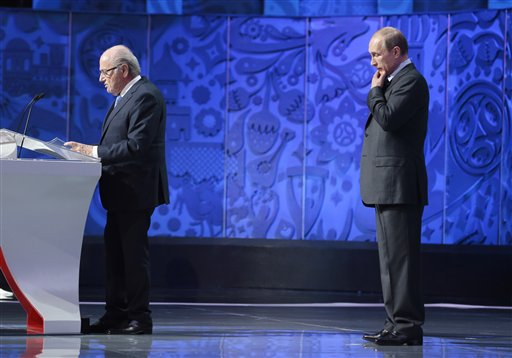 Russian President Vladimir Putin, right, ponders during a speech of FIFA President Sepp Blatter during the preliminary draw for the 2018 soccer World Cup in Konstantin Palace in St. Petersburg, Russia, Saturday, July 25, 2015. (AP Photo/Ivan Sekretarev)