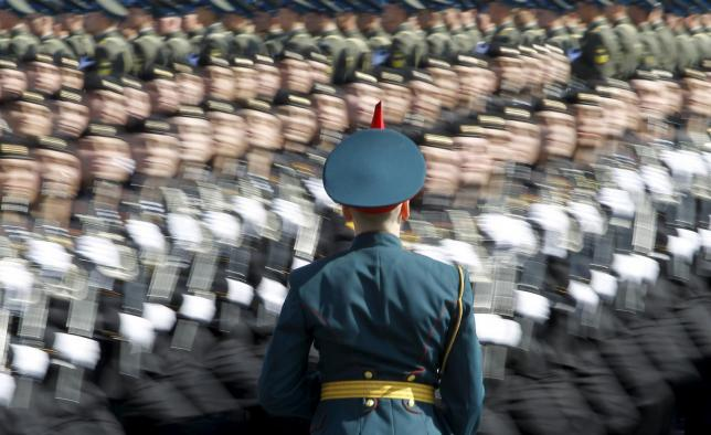 A Russian soldier stands at attention as troops march past during a general rehearsal for a Victory Day parade at Moscow's Red Square, in this May 6, 2012 file photo.  Photo: Reuters/File