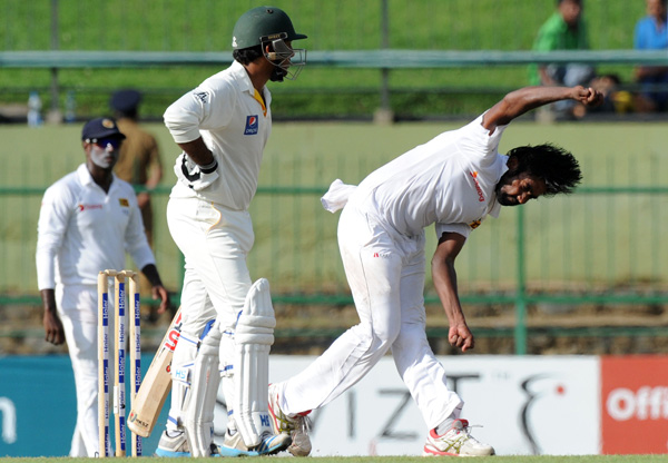 Sri Lankau0092s Nuwan Pradeep (right) bowls against Pakistan during the second day of their third and final Test match at the Pallekele International Cricket Stadium on Saturday. Photo:AFP