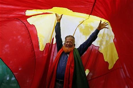 A Bangladeshi activist celebrates after the Supreme Court cleared the way for the execution of opposition Bangladesh Nationalist Party leader Salauddin Quader Chowdhury, convicted of war crimes in Dhaka, Bangladesh, Wednesday, July 29, 2015. AP