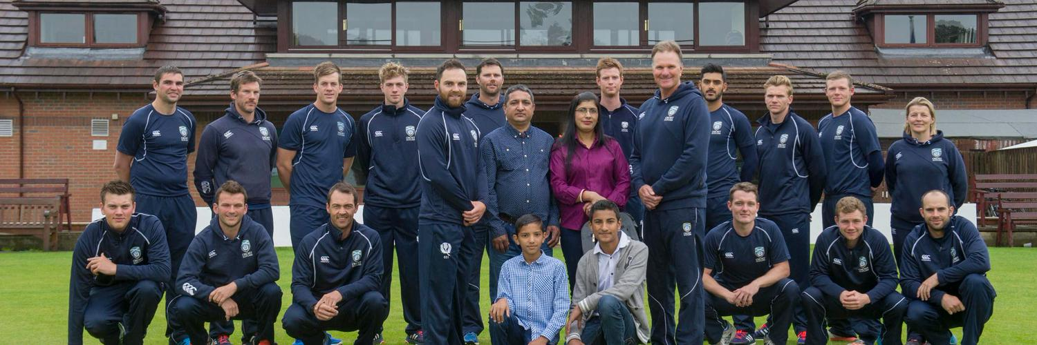 nnScotland-based Nepalis-- Dilliraj Bhandari his wife, Sita, and sons Puskar (14) and Narahari (11) - who play cricket for Ayr CC youth teams - with Scotland Captain Preston Mommsen (centre left), Head Coach Grant Bradburn (centre right) and players and support staff leading off the Appeal in front of the Ayr CC clubhouse. Photo: Scotland Cricket