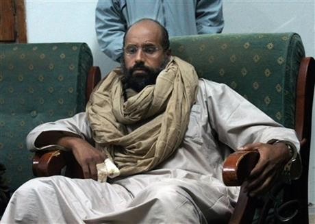 FILE - In this Saturday, Nov. 19, 2011 file photo, Seif al-Islam is seen after his capture in the custody of revolutionary fighters in Zintan. A court in the Libyan capital has sentenced Seif al-Islam to death over killings during the country's 2011 uprising. AP