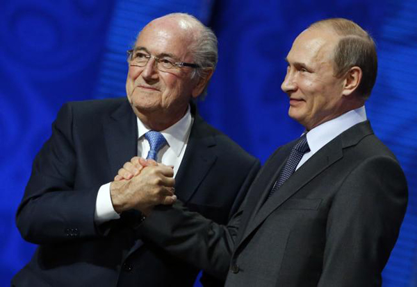 FIFA's President Sepp Blatter shakes hands with Russia's President Vladimir Putin (right) during the preliminary draw for the 2018 FIFA World Cup at Konstantin Palace in St. Petersburg, Russia July 25, 2015. Photo: Reuters