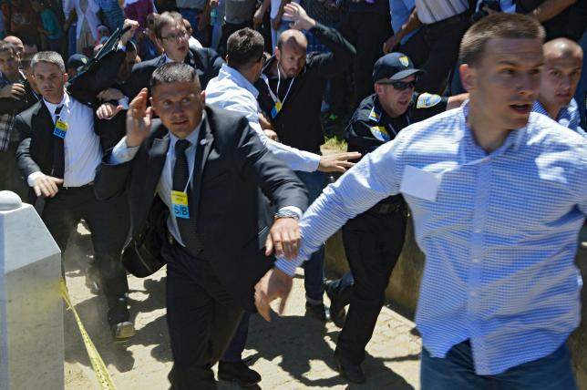 Bodyguards protect Serbia's Prime Minister Aleksandar Vucic (3rd L with spectacles) during unrest at a ceremony marking the 20th anniversary of the Srebrenica massacre in Potocari, near Srebrenica, Bosnia and Herzegovina, July 11, 2015. REUTERS/Sanel Mumic