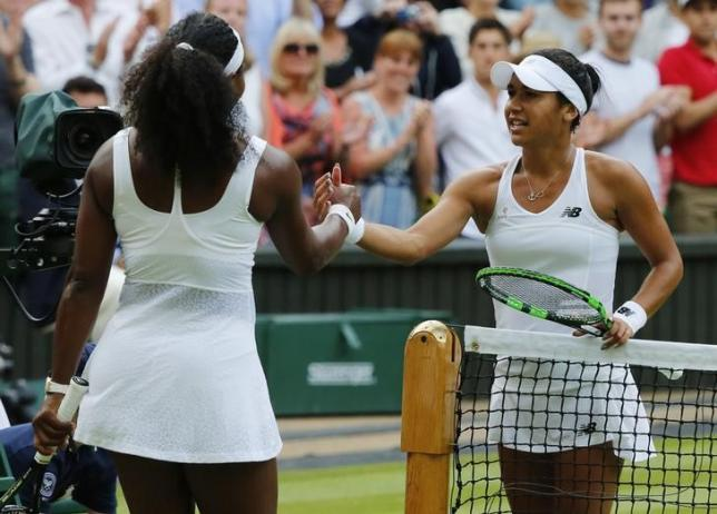Serena Williams of the U.S.A. shakes hands with Heather Watson of Britain (R) after winning their match at the Wimbledon Tennis Championships in London, July 3, 2015.               REUTERS/Stefan Wermuth