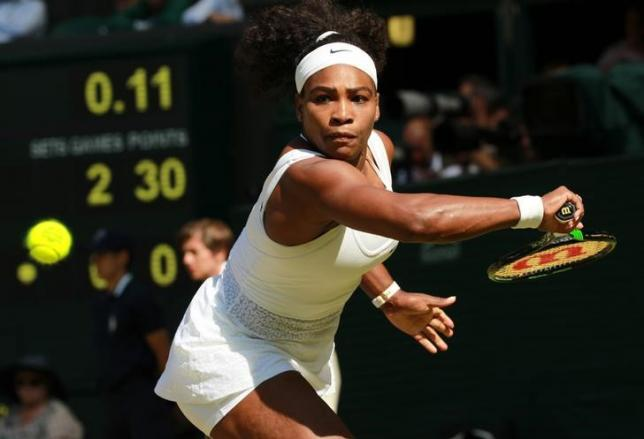 Serena Williams of the U.S.A. hits a shot during her match against Maria Sharapova of Russia at the Wimbledon Tennis Championships in London, July 9, 2015.                                     REUTERS/Sean Dempsey/Pool