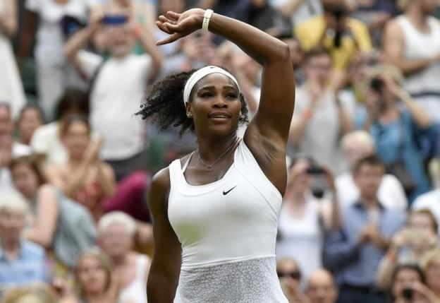 Serena Williams of the U.S.A. celebrates after winning her match against Timea Babos of Hungary at the Wimbledon Tennis Championships in London, July 1, 2015.        REUTERS/Toby Melville