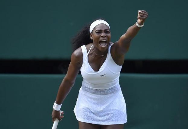 Serena Williams of the U.S.A. reacts during her match against Victoria Azarenka of Belarus at the Wimbledon Tennis Championships in London, July 7, 2015.                        REUTERS/Toby Melville