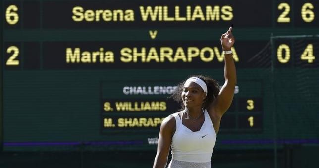 Serena Williams of the U.S.A. celebrates after winning her match against Maria Sharapova of Russia at the Wimbledon Tennis Championships in London, July 9, 2015.                                    REUTERS/Toby Melville