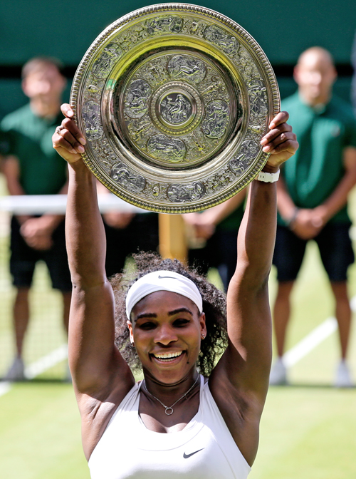 Serena Williams of the United States holds aloft the Wimbledon trophy in London on Saturday. Photo: AP