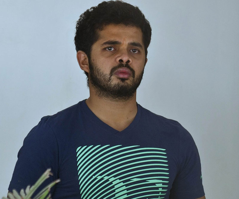 In this photograph taken on May 28, 2013, Indian cricketer Shanthakumaran Sreesanth looks on before being taken to court in New Delhi. Photo: AFP