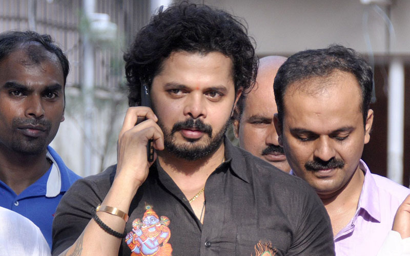 Shanthakumaran Sreesanth speaks on his mobile as he leaves Patiala Court in New Delhi on Saturday. Photo: AFP