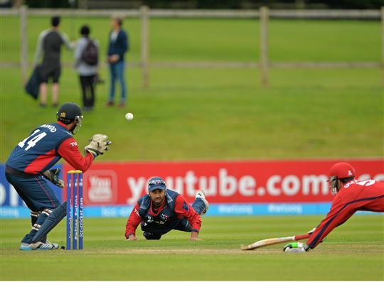 Sharad Vesawkwar and Binod Bhandari in action against Peter Gough of  Jersey in their ICC World Twenty20 Qualifier match at Malahide, Dublin. Photo: ICC/Sportsfile