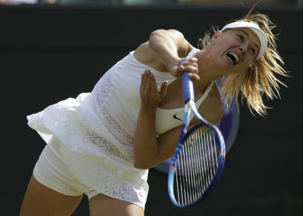 Maria Sharapova of Russia returns to Irina-Camelia Begu of Romania during their womenu0092s singles match at the All England Lawn Tennis Championships in Wimbledon, London on Friday. Sharapova won the match 6-4, 6-3.nPhoto:AP
