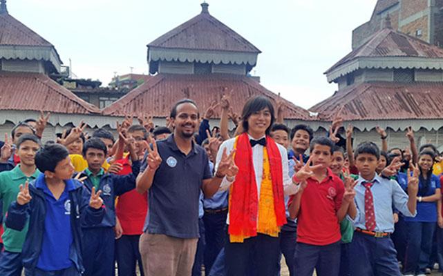 Japanese actor Shun Shioya of childrenu0092s series Power Ranger Ninja Storm posing for a photograph with students of Samata School, in nKathmandu, on Wednesday. Photo Courtesy: Sushil Adhikari