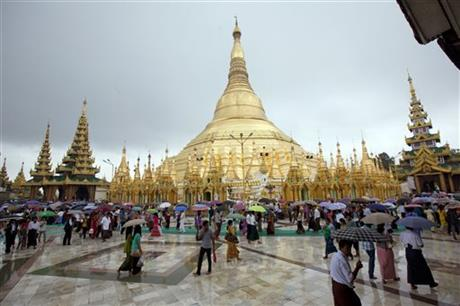 Buddhist devotees hold umbrellas as they visit Myanmar's famous Shwedagon Pagoda in the rain during the full moon day of Waso, the fourth month of Myanmar calendar and the beginning of Buddhist Lent, Friday, July 31, 2015, in Yangon, Myanmar. AP