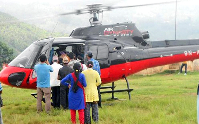 Journalist Shyam Krishna Dahal, who is a kidney patient, being airlifted to Kathmandu for treatment, at Taksar Airport in Bhojpur, on Monday.