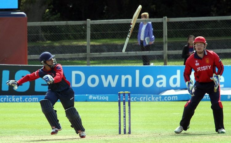 Nepal's Siddhant Lohani loses his bat as Jersey wicketkeeper Edward Farley looks on during their ICC World Twenty20 Qualifiers Group A match in Dublin on Saturday. Photo: THT