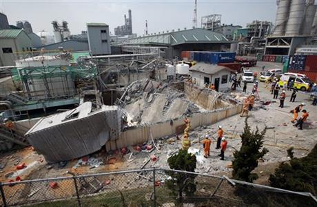A distorted waste storage facility is seen after an explosion at a chemical plant run by Hanwha Chemical Co. in Ulsan, South Korea, Friday, July 3, 2015. AP