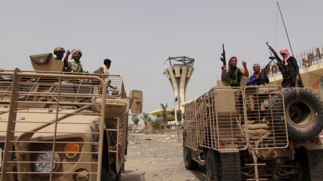 Southern Resistance fighters ride armoured personnel carriers at the international airport of Yemen's southern port city of Aden, July 14, 2015.  REUTERS/Stringer