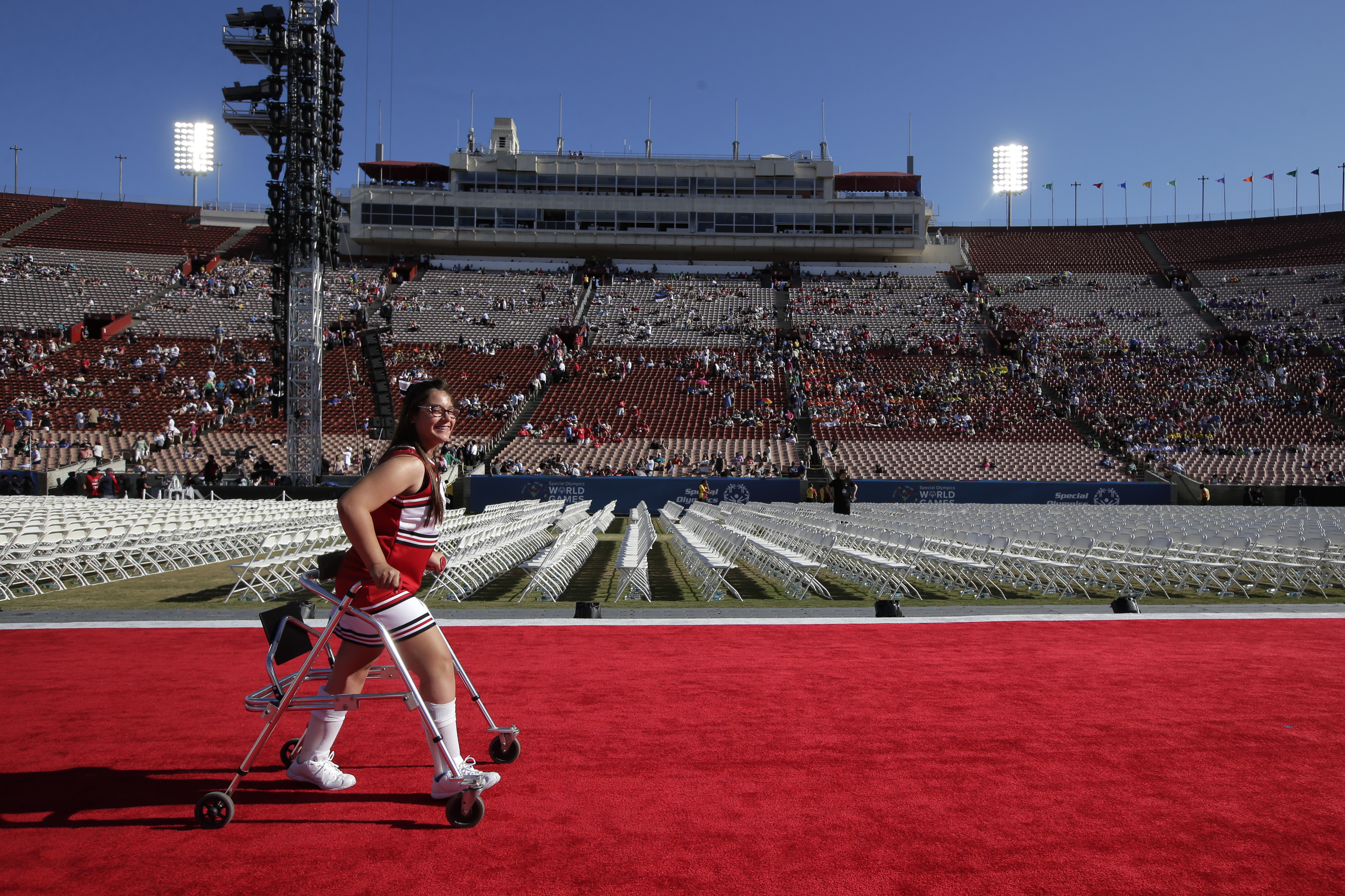 Cheerleader Tiana DiMassa, 14, of Garden Grove, Calif., leaves the stadium after her pre-show performance at the opening ceremony of the Special Olympics World Games, Saturday, July 25, 2015, in Los Angeles. Some 6,500 athletes from 165 countries u0097 the most to converge on Los Angeles since the 1984 Summer Olympics u0097 have poured into town this week to hit tennis balls, kick soccer balls, swim laps, ride horses, lift weights, even run a triathlon. Photo: AP