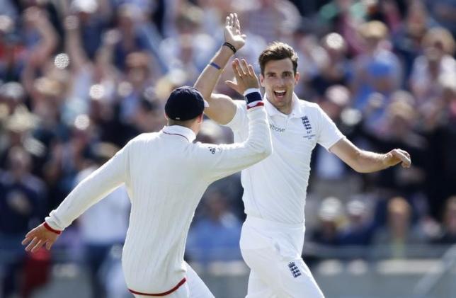 Cricket - England v Australia - Investec Ashes Test Series Third Test - Edgbaston - 30/7/15nEngland's Steven Finn celebrates the wicket of Australia's Adam Voges with team matesnAction Images via Reuters / Carl RecinenLivepic