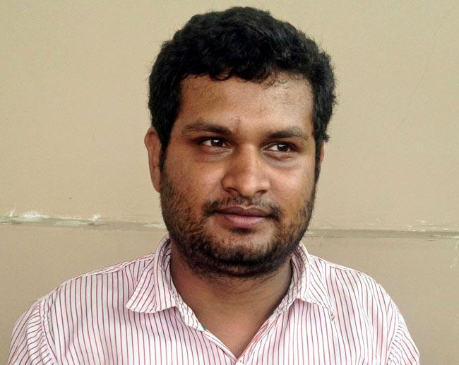 Sujan Neupane in police custody. Photo: MPCD