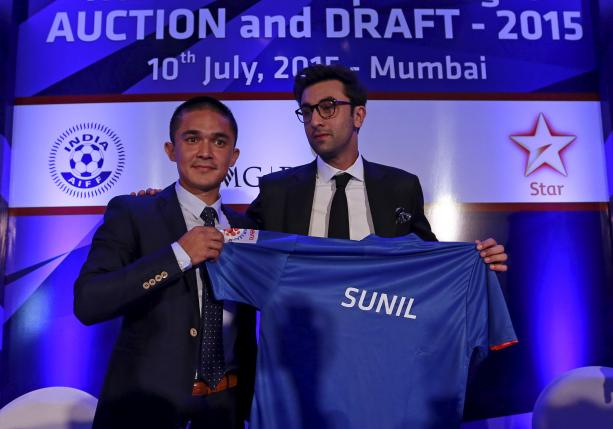 Mumbai City FC player Sunil Chhetri poses with the team co-owner and Bollywood actor Ranbir Kapoor at a news conference during the domestic player auction and draft for the Indian Super League in Mumbai, July 10, 2015. REUTERS/Danish Siddiqui