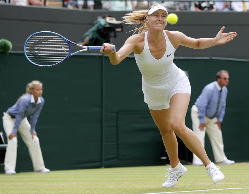 Maria Sharapova of Russia hits a shot during her match against Zarina Diyas of Kazakhstan at the Wimbledon Tennis Championships in London, July 6, 2015.                   Photo: Reuters