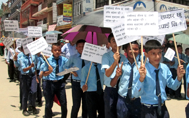 Students carrying placards as they participate in a rally organised by District Education Committee declaring Tanahun a fully literate district, in Damauli, on Monday. Photo: THT