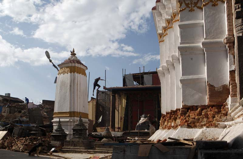 Nepali workers tear down a monastery that was damaged in an earthquake at the Swayambhunath Stupa in Kathmandu, on Thursday, June 18, 2015. Photo: AP