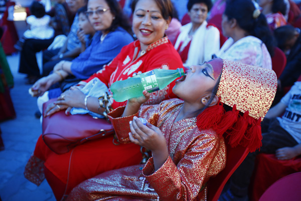 A girl, who was born as a test tube baby, having soft drinks during a special function, where those born as test tube babies had gathered, in Om Hospital, Chabahil, Kathmandu, on Friday. Photo:Skanda Gautam/THT