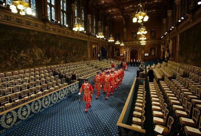 Yeoman of the Guard, wearing traditional uniform, walk through the Royal Gallery during the ceremonial search before the State Opening of Parliament in the House of Lords at the Palace of Westminster, in central London June 4, 2014. Photo:Reuters