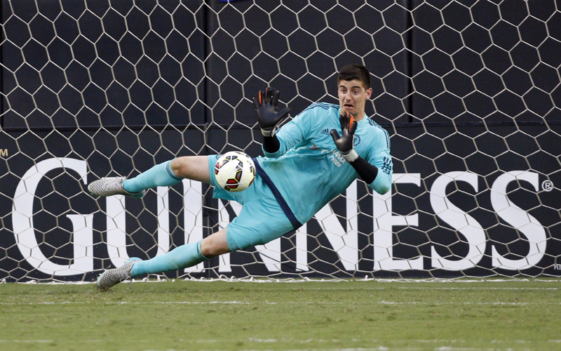 Chelsea's goalkeeper Thibaut Courtois stops a penalty kick after the second half of an International Champions Cup match against PSG in Charlotte on Saturday. Photo: AP