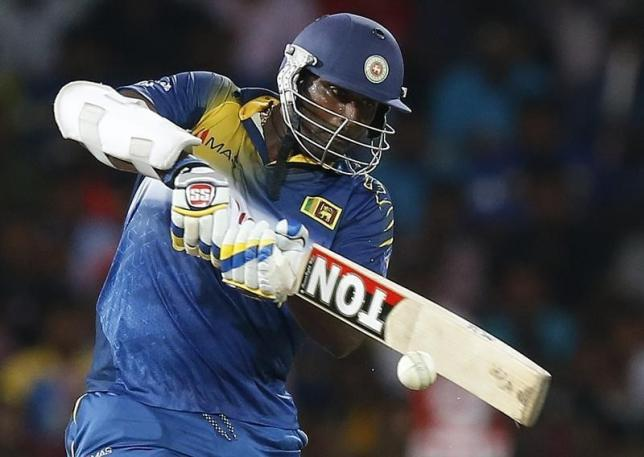 Sri Lanka's Thisara Perera plays a shot during their final ODI (One Day International) cricket match against England in Colombo, December 16, 2014. REUTERS/Dinuka Liyanawatte