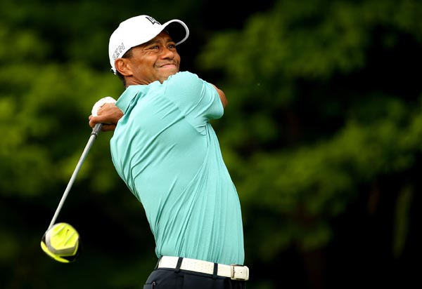 Tiger Woods tees off on the 17th hole during the first round of the Greenbrier Classic at the Old White TPC in Cary, West Virginia on Thursday. Photo: AFP