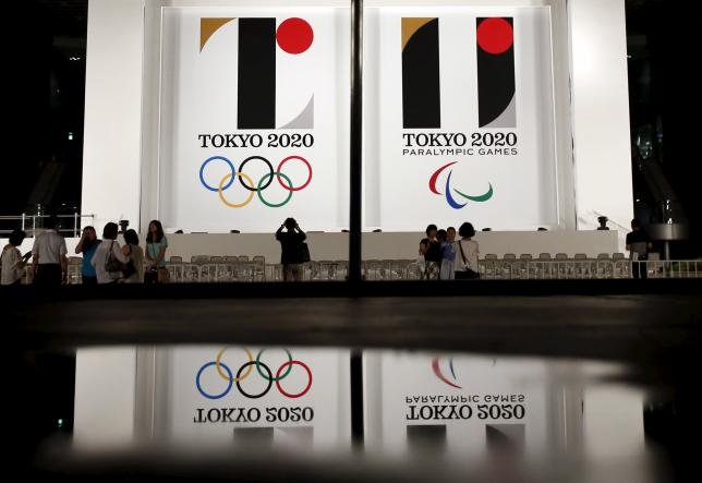 Tokyo 2020 Olympic and Paralympic games emblems are displayed at Tokyo Metropolitan Government Building in Tokyo July 24, 2015. REUTERS/Issei Kato