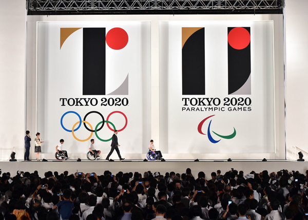 The logos of the 2020 Tokyo Olympic and Paralympic Games are unveiled at the Tokyo city hall on Friday. The logos are designed with black columns symbolising diversity and bright red circles which indicate people's heart. Photo: AFP