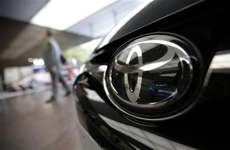 FILE - In this May 8, 2015 file photo, Toyota logo on a car is seen at Toyota's headquarters building in Tokyo. Japanese automaker Toyota Motor Corp. said Tuesday, July 28, 2015 it sold 5.02 million vehicles in the first six months of this year, down 1.5 percent from the same period the previous year, as sales struggled especially in the languishing Japanese market. Photo: AP