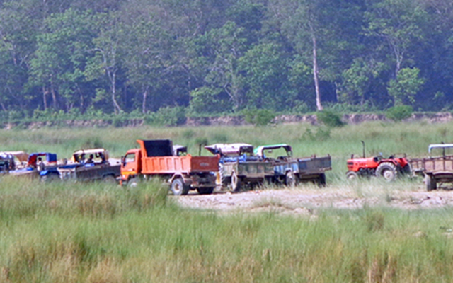 Tractors being used for mining in the Lalbakaiya River, in Nijgadh, Bara, on Monday, July 13, 2015. Photo: THT