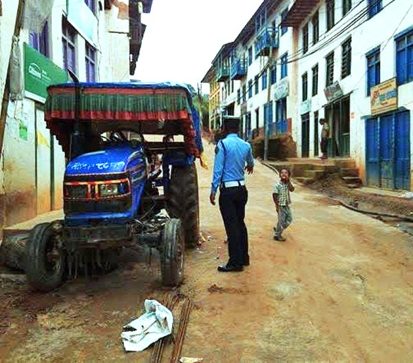 Traffic police removing an illegally parked tractor from the road in Bhojpur on Monday, July 20, 2015. Photo: Niroj Koirala